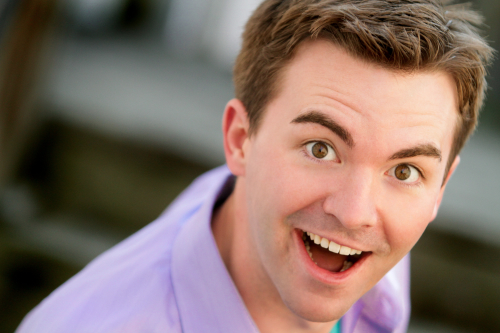 Caucasian male in lavender shirt with surprised expression