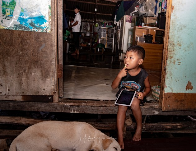 Migrant Burmese Boy and dog Play