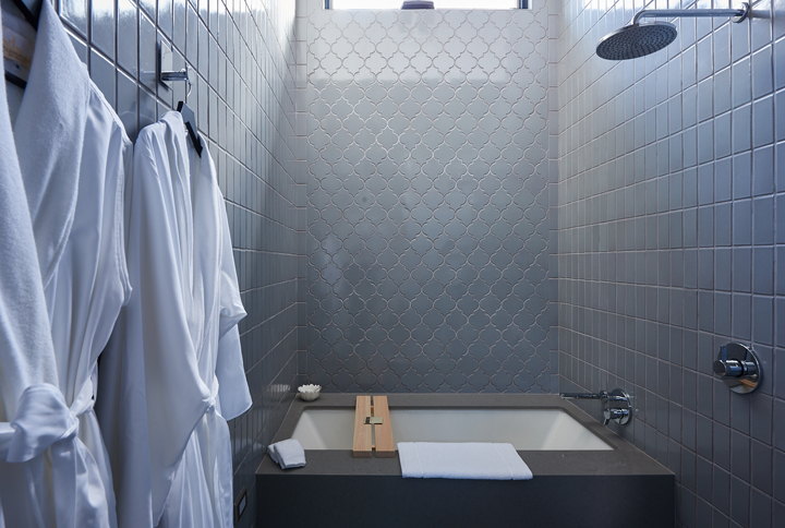 Hand laid Fire Clay tile add warmth to this spa like guest bath.