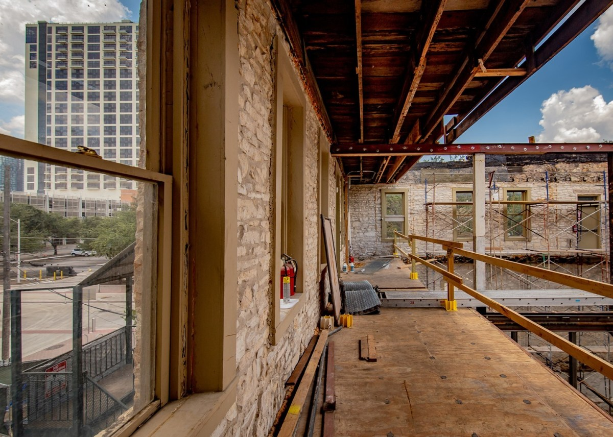 Adaptive reuse of a historic building becomes a whole lotta fun when you get to pop the roof off to make room for a stunning deck with downtown views. 