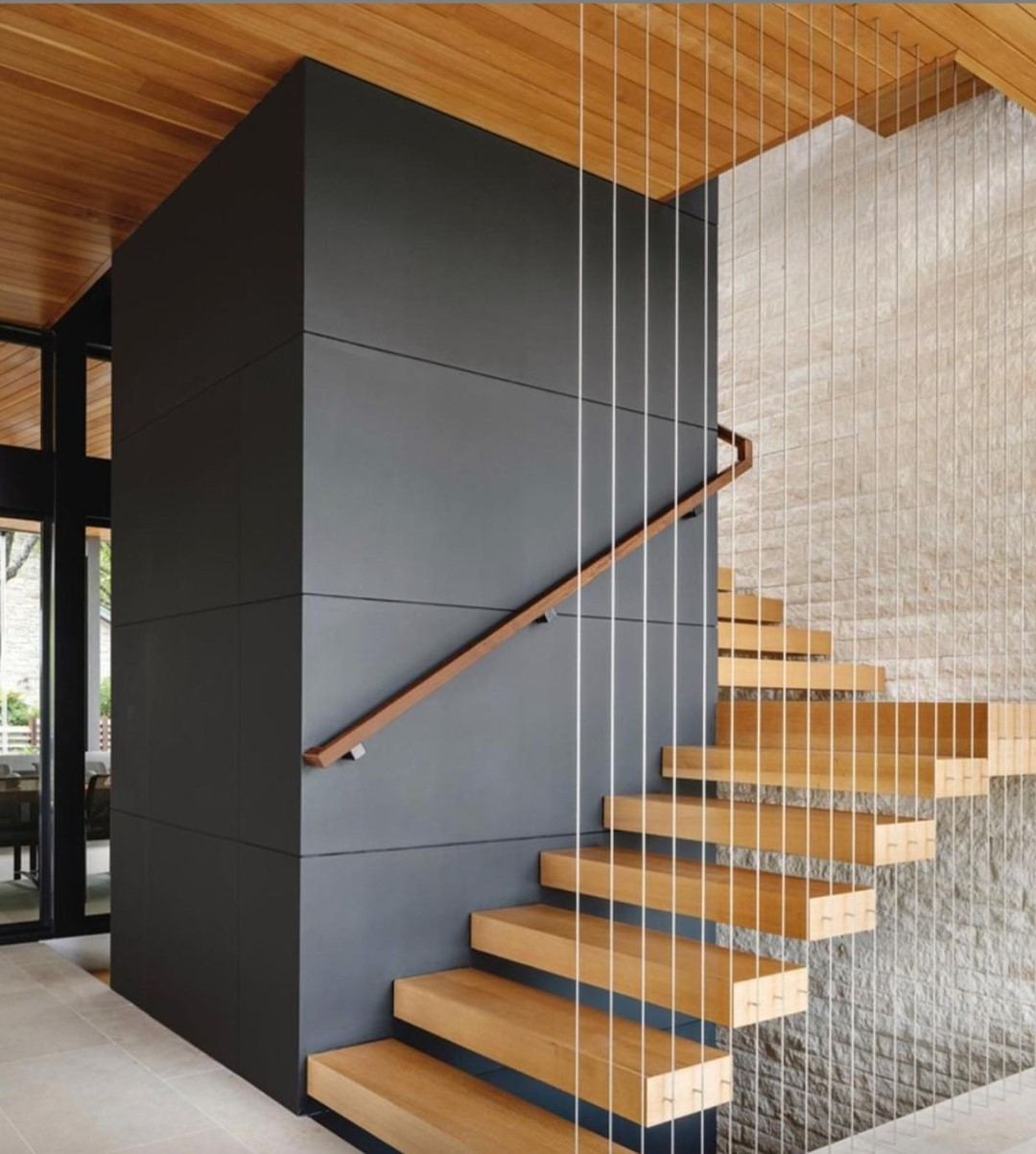 You would never know the amount of steel needed to make this beautiful cantilevered staircase seem so light and airy.   And that's exactly how we know we're doing a good job.