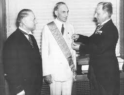 Henry Ford was awarded the Medal of the German Eagle, the highest honor granted to a foreigner.  Here we see the consul Karl Kapp, who gave him his decoration in 1938.