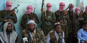 Godane entouré de miliciens...dont certains sont des pirates.