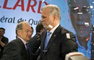 Raymond  Bachand et Philippe Couillard, des rictus qui parlent d'amertume politique