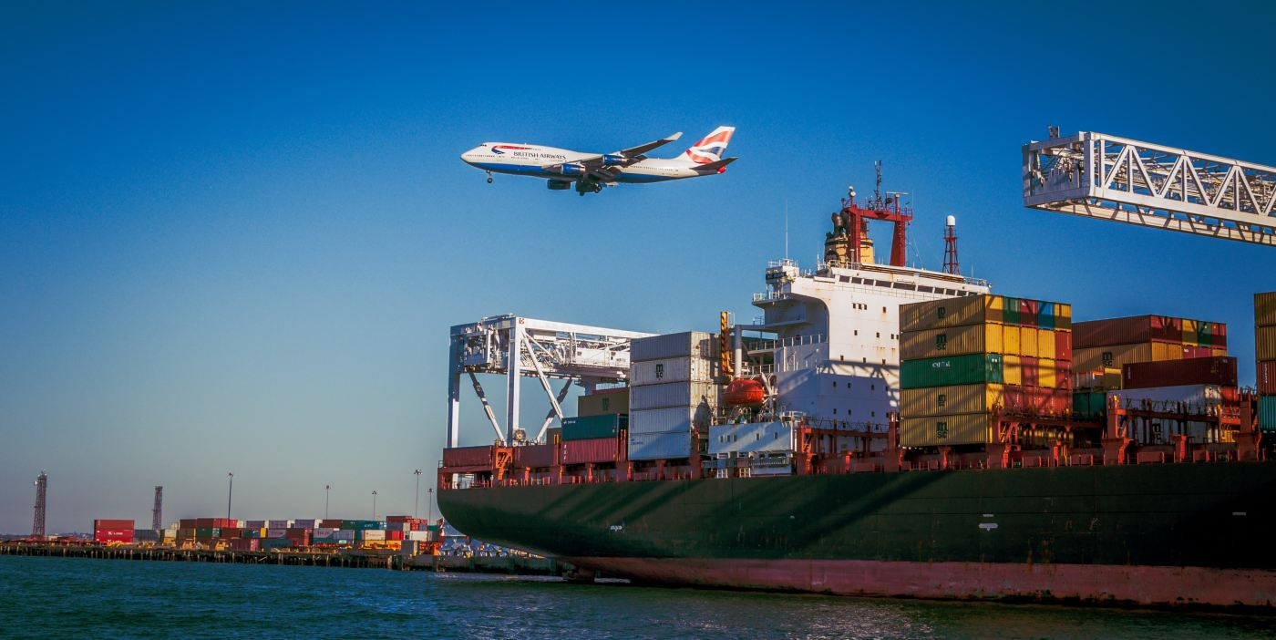 Container ship and plane