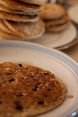 Day 185 For breakfast today, I made a few pancakes sprinkled with sunflower seeds while they were cooking.  And my last big pancake, for me, I also sprinkled on cinnamon and raisins. :)  50mm  Manual  ISO800  f/1.8  1/125sec  lightened in LR