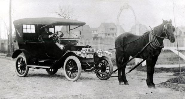 horse-pulling-old-car
