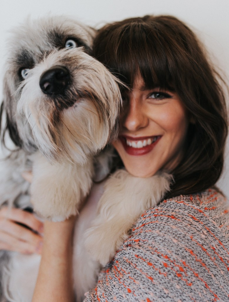 In this self portrait, Michelle holds her aussiedoodle, Indy up to the camera.
