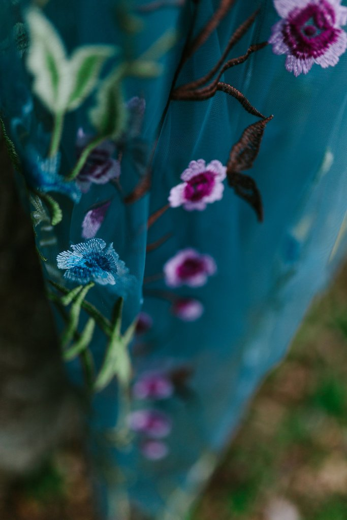 Details of Wren's sheer blue dress with floral embroidery, bought at Dezzal.