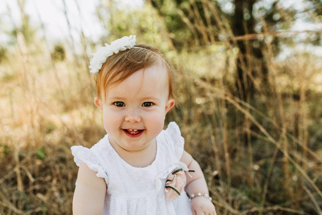 Spring-First-Birthday-Girl-Luagh-Smile