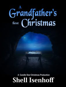 An empty manger inside a cave under the star of Bethlehem.