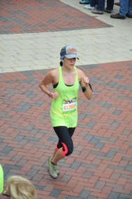 Michelle about to cross the finish line of her half-marathon