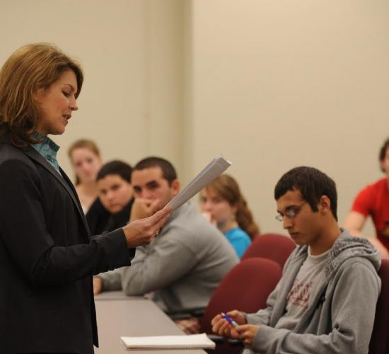Dr. Michelle K. Johnston, Leadership Coach, Management Professor, and Keynote Speaker, talks with students at Loyola University New Orleans.