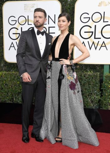 Justin Timberlake and Jessica Biel are a major miss in these clashing patterns, and Biel shows how the night's daring low-cut trend can backfire at the Golden Globe Awards on January 8, 2017 in Beverly Hills, California. (Photo by Frazer Harrison/Getty Images)