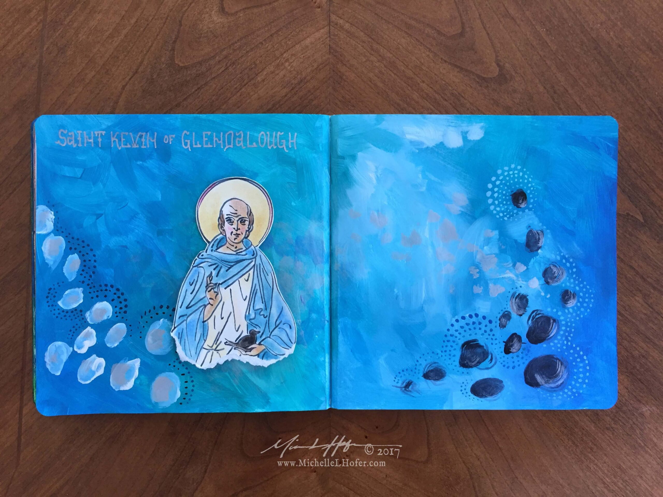 The Solitude of Saint Kevin - Abstract acrylic painted double-page book spread featuring a pen and ink portrait of Saint Kevin of Glendalough with hand lettered name from the Book of Saints by Michelle L Hofer.