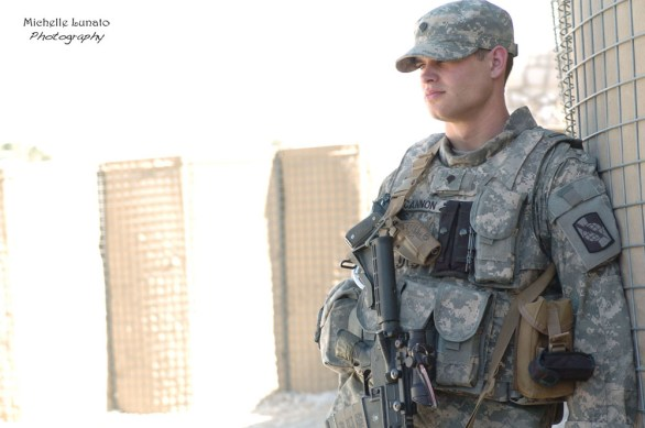 An American Soldier stands by during the after-mission briefing.
