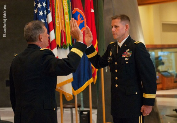 Maj. Gen. Mark T. McQueen, commander of the 108th Training Command (Initial Entry Training), administers the Oath of Office to Brig. Gen. Miles Davis during a promotion ceremony on September 11th at the National Infantry Museum at Fort Benning. Shortly after the promotion ceremony, Brig. Gen. Davis assumed command of the 98th Training Division (IET) on the parade field of the museum.