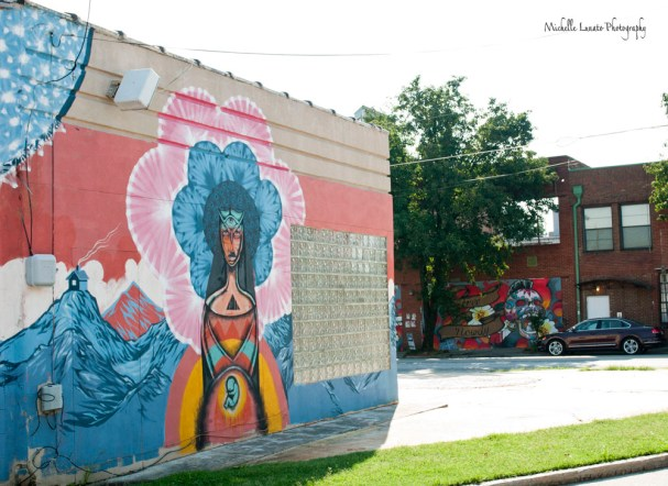 A shot of two murals on neighboring buildings.