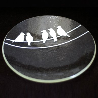 Birds on a wire in white, on clear glass