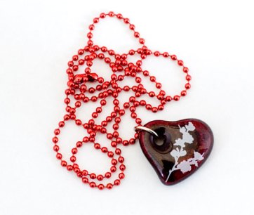 Cherry branch design in white, on red cast glass heart pendant