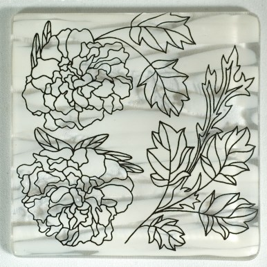 Floral designs in black, on patterned white coaster