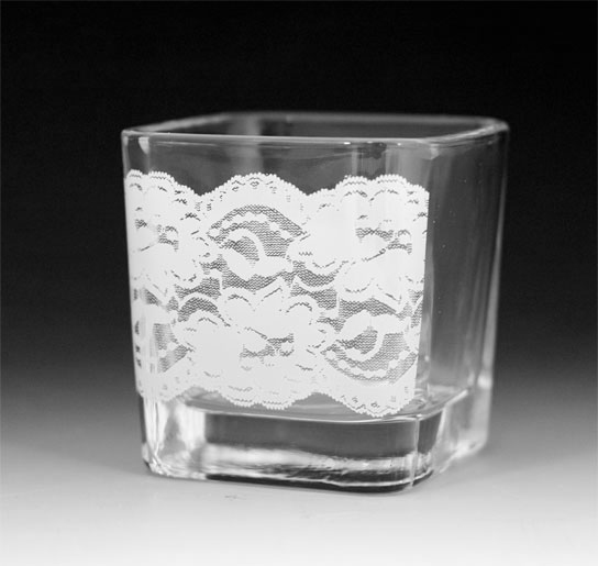 Lace design in white, on clear glass tea light holder