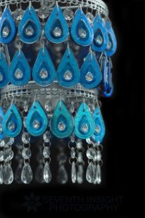 Hand carved, drilled, and fused dichroic glass raindrop chandelier with 2 carat cubic zirconias fired into each raindrop. By Michelle Prosek