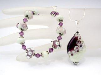 Flame worked glass jewellery set by Sylvia Shekalo Glass