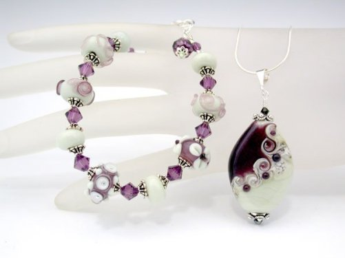 Flame worked glass jewellery set by Sylvia Shekalo Glass