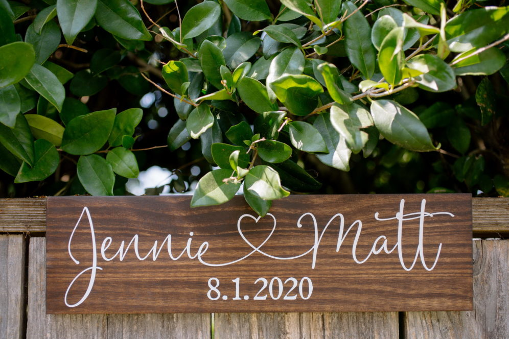 hand lettered sign for a backyard wedding