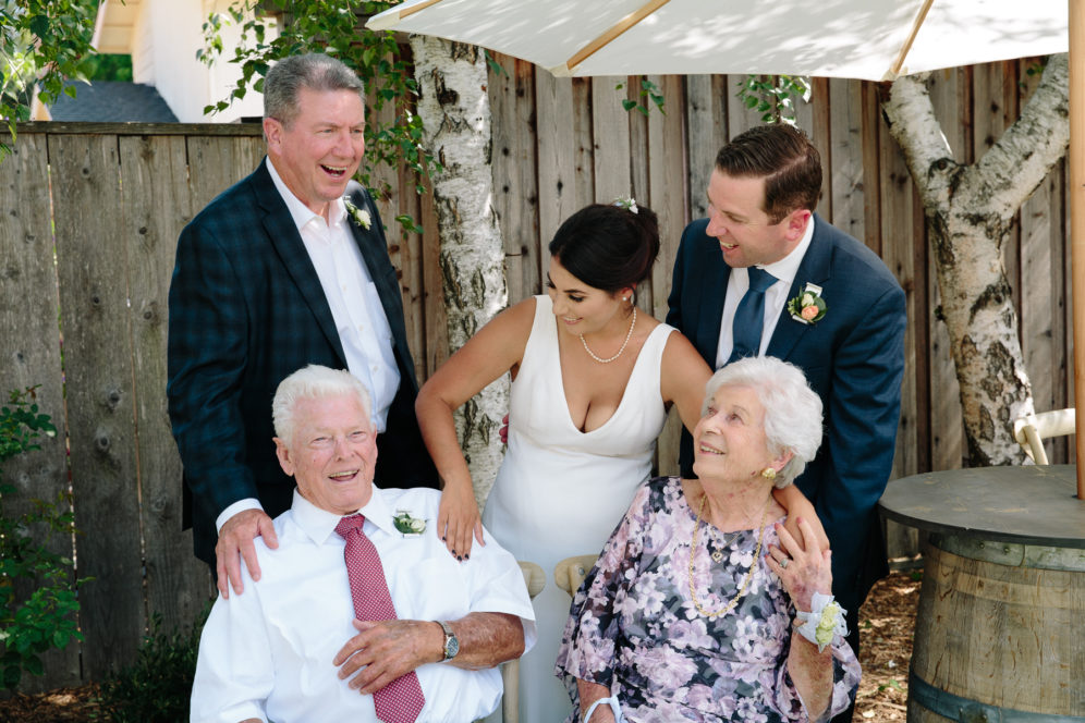 casual backyard wedding portrait with grandparents