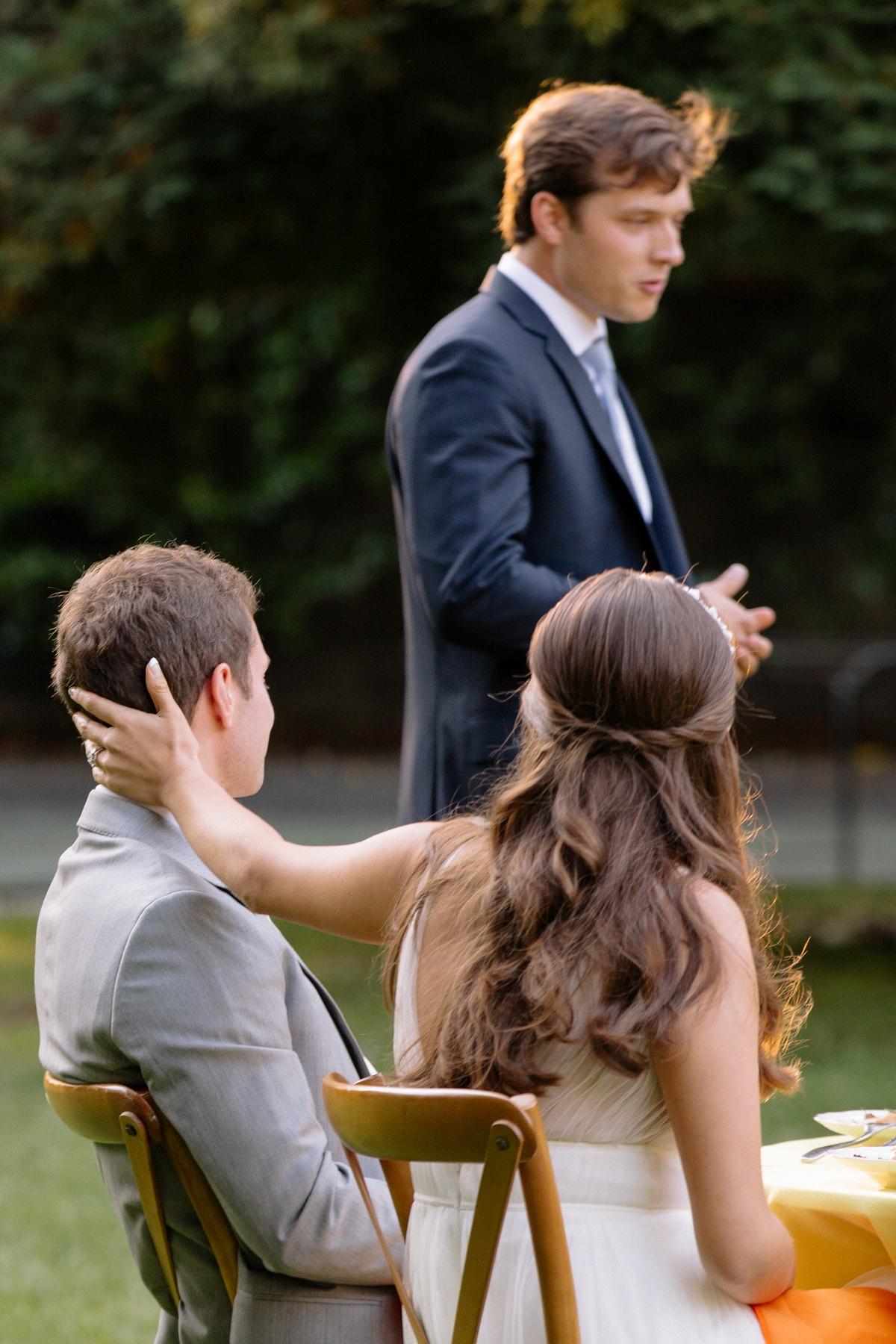 best man giving toast at a backyard wedding