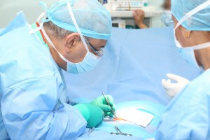 Doctor making a suture in operation room