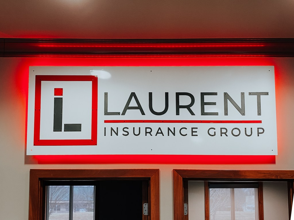 Commercial metal sign created for  the entryway for Laurent Insurance Group.
