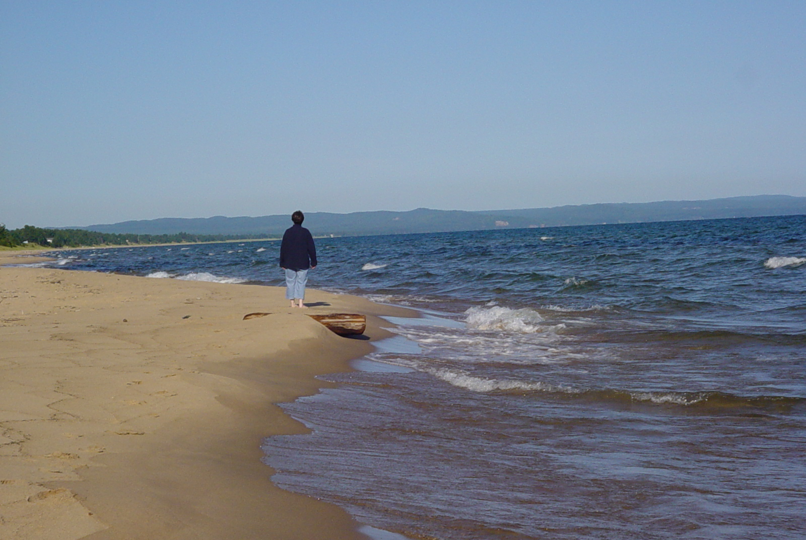 This beach walker on Lake Superior just east of Marquette is probably in the right spot.
