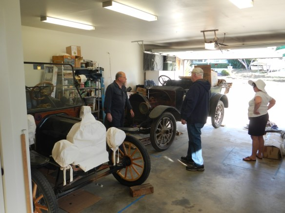 "Our 1914 Ford Model T and the 1912 Michigan. Ready to move the ""Big Car"" to the workshop. Clarence & Sally Davis assisting."