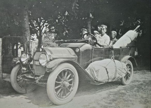 This is a 1913 Model R. note the painted radiator with M medallion & pin stripes on body and hood, electric lights, running board tool chest. License plate shows OREgon.