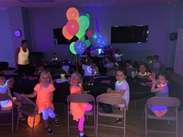 Put highlighters and paper on tables for the kids who don't want to play games. Did you know highlighters glow in the dark?