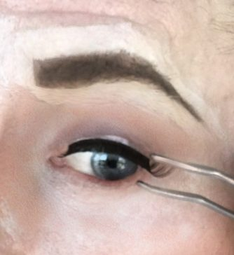 crossdresser makeup for false eyelash application
