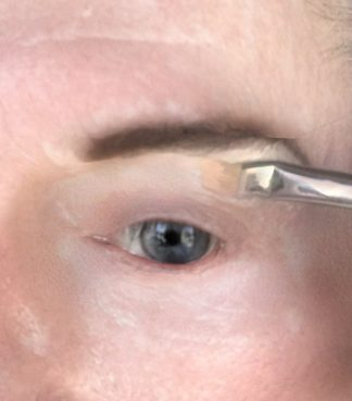 crossdresser makeup eye concealer applied nder brow