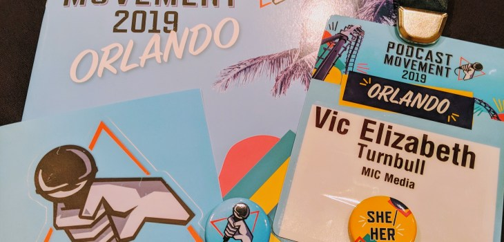 a photo of the podcast movement 2019 delegate pack with a programme, pass on a lanyard and 2 badges