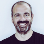 a man short beard, smiling