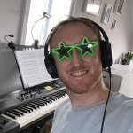 Image of Andy smiling with headphones on and star sunglasses on with a green frame and a piano in the background