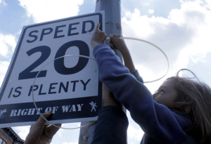 Reduce speed limit by putting up DIY speed limit sign