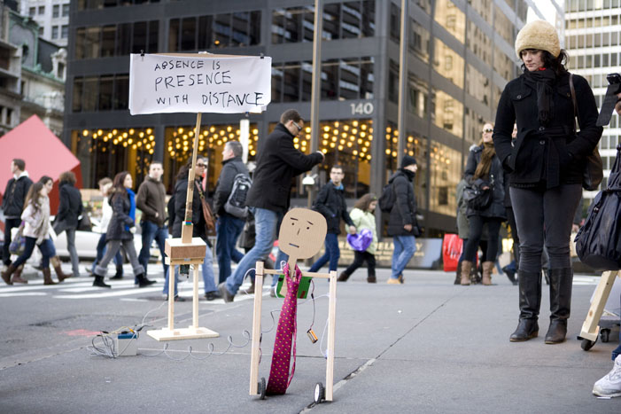 Occu-bot, automated protest support that shakes a sign on behalf of weary protestors. By Taeyoon Choi