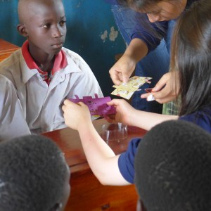 Showing the students how the Foldscopes work