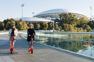 Riders taking advantage of the e-scooter share scheme to cross the Adelaide Riverbank Pedestrian Bridge. More than 460,000 e-scooter trips were undertaken through the scheme during the first six months of 2021.