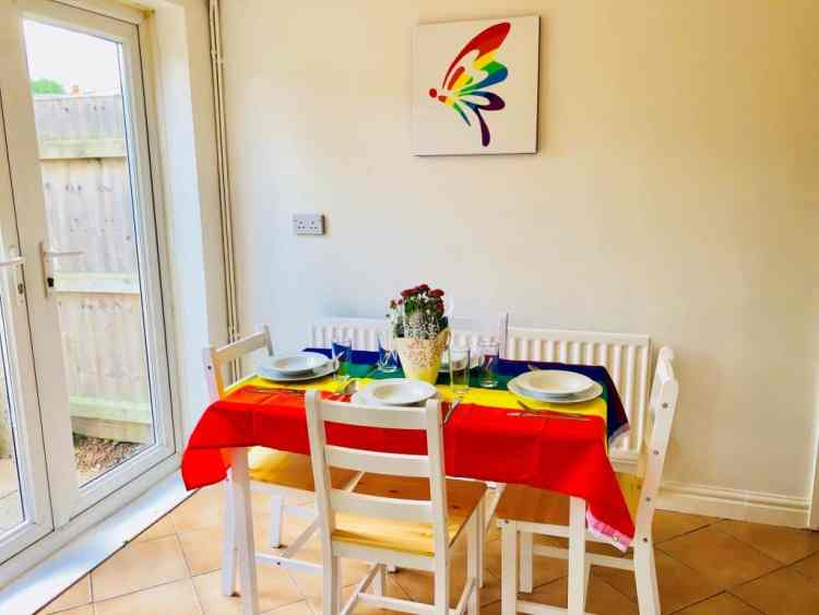 Dining room with rainbow flag