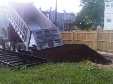 15 yards of soil and 7 yards of woodchips brought in