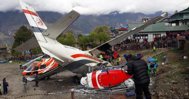 Plane collide with two helicopters Nepal plane crash leaves three dead at one of world's most dangerous airports in Lukla airport.